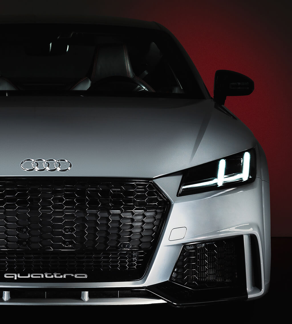 Front close-up of a silver-grey Audi Quattro sports car