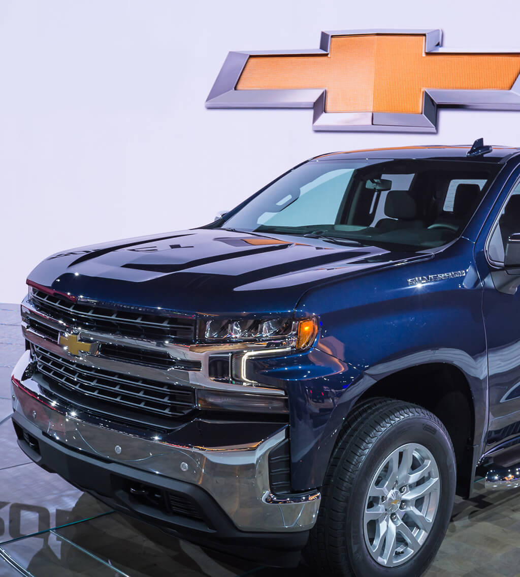Front view of a blue Chevrolet Silverado performance truck