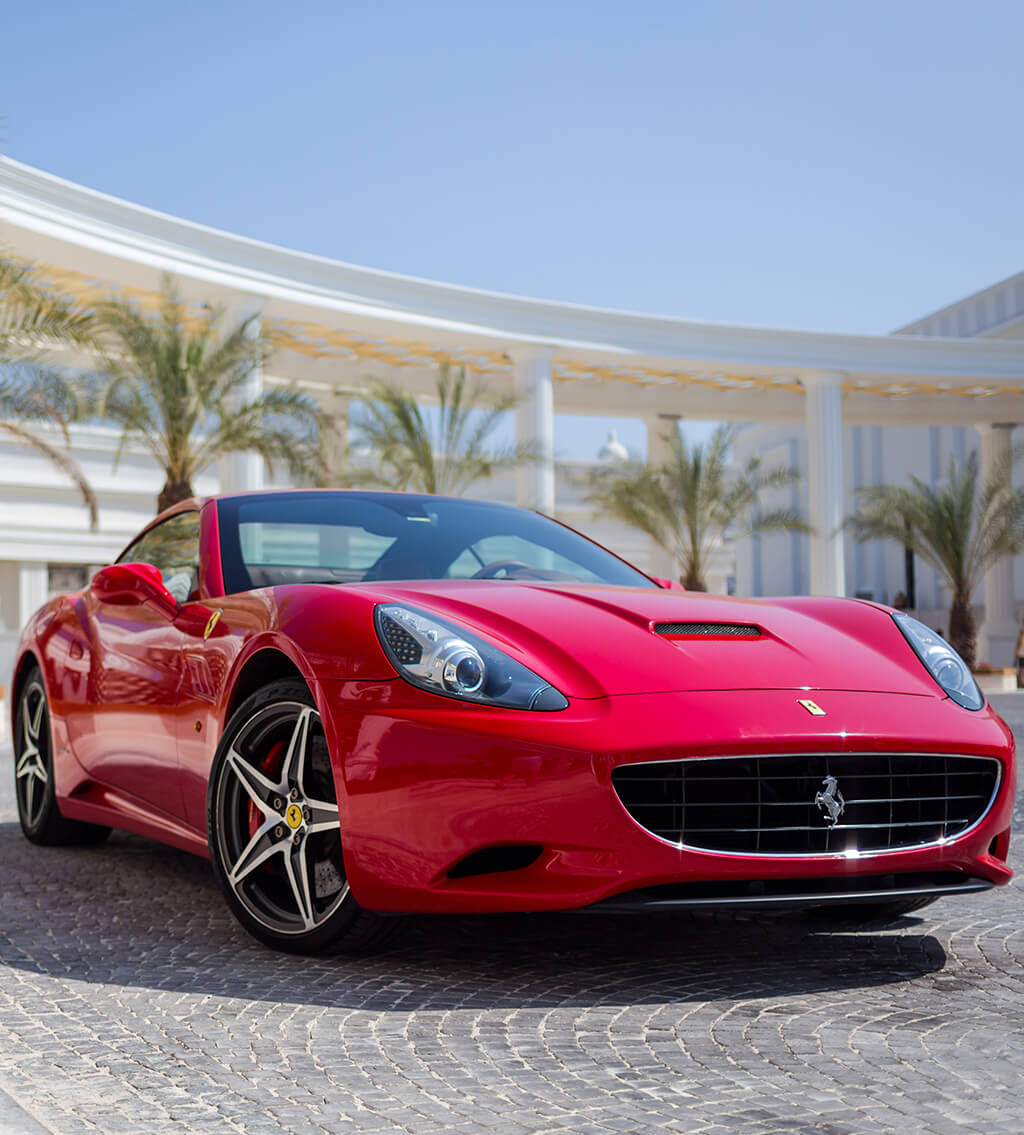 Front view of a red Ferrari sports car parked outdoors