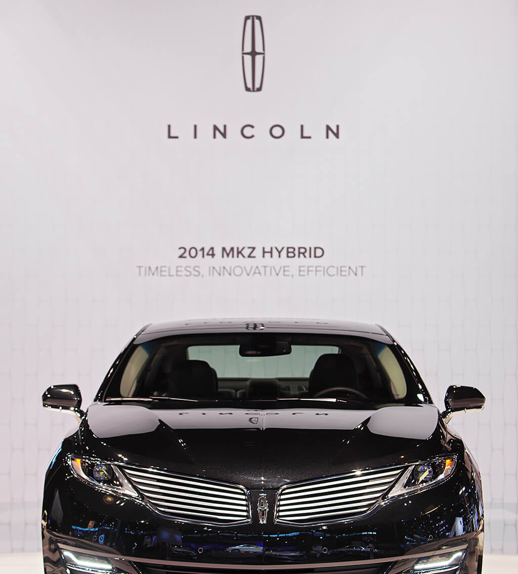"""Poster of the Lincoln 2014 MKZ Hybrid luxury sedan, with the front view of the black sedan and the text """"Timeless, Innovative, Efficient"""""""