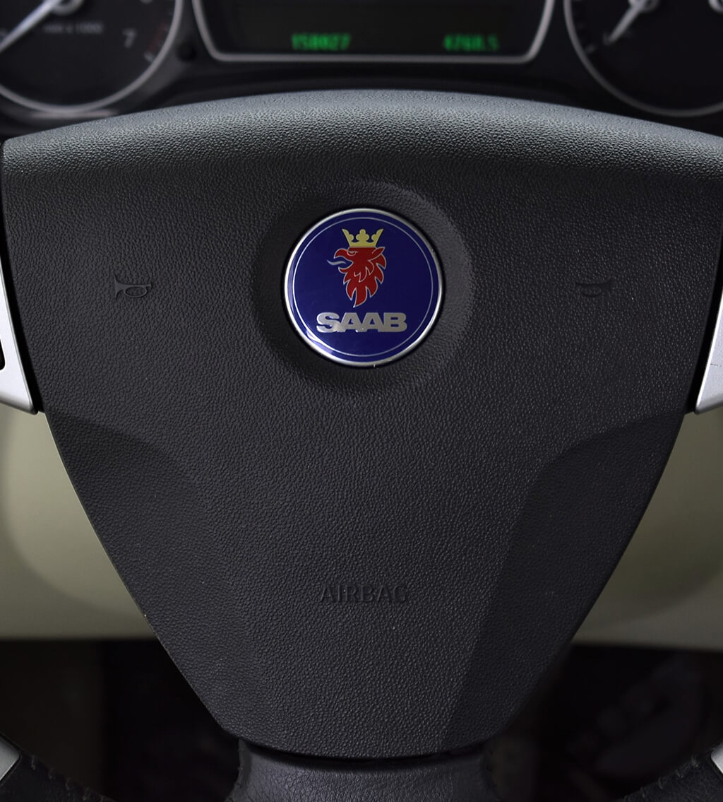 Steering wheel with the logo of Saab Automobile, a Swedish vehicle manufacturer that closed in 2013