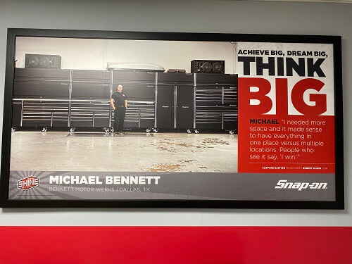 "Founder and owner Michael Bennett's photo displayed at the repair shop with the caption ""Think Big"""