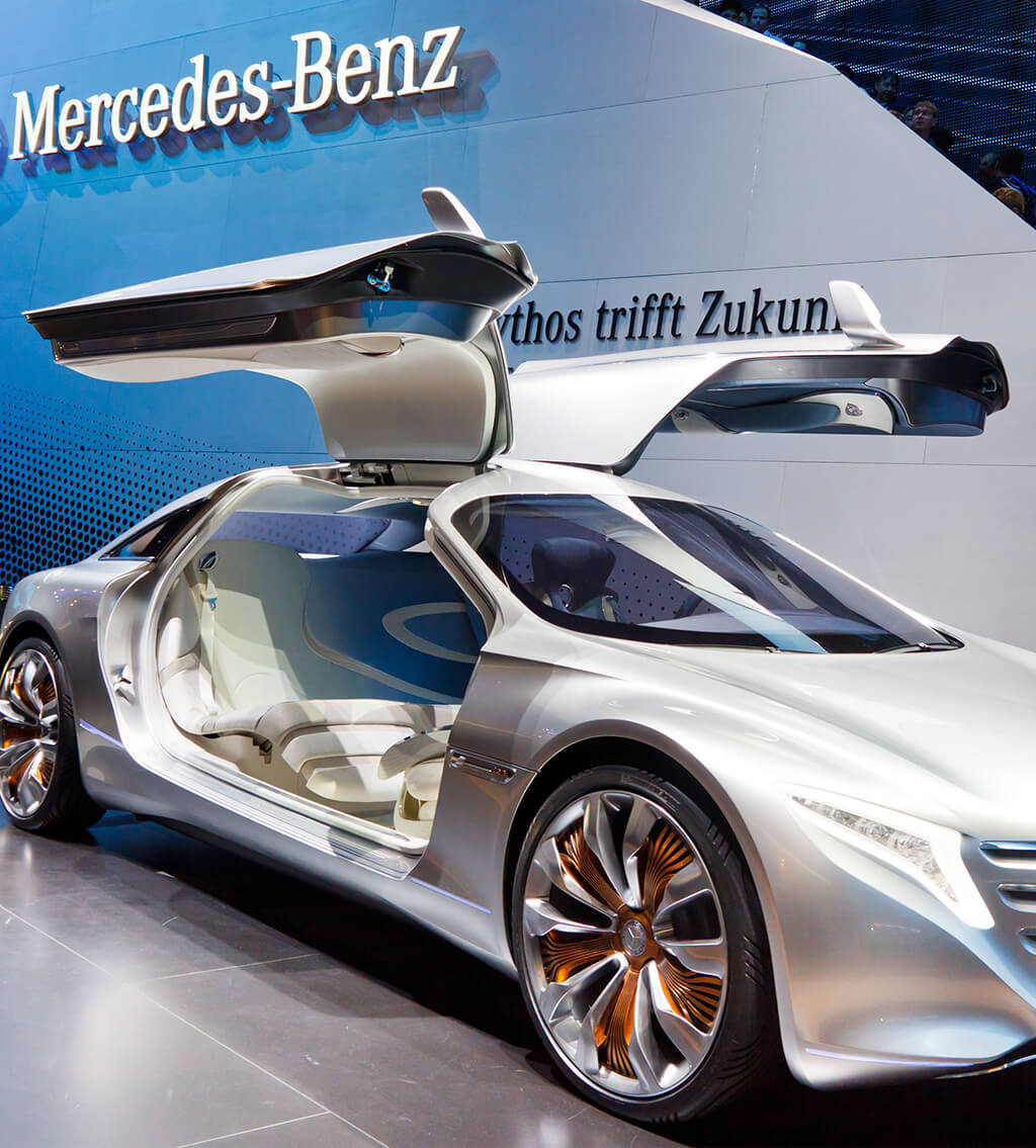 Mercedes-Benz display of a silver-grey sedan with opened butterfly doors